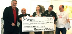 (L) Brant MPP Dave Levac presents the ubiquitous 'big cheque' government grant money in April of this year to Hockeyfest Inc. director Ralph Spoltore (R). The province awarded 350,000$ to Hockeyfest for the recently cancelled June event. Last year Hockeyfest Inc. received 400,000$ for 2011's Walter Gretzky streethockey and music event. Some question the claim of 'roaring success' claimed by organizers due to the temporary nature of the jobs created and the investment of public tax revenue. The cheque in this image is for 488,500$ because other Brant groups also received province funding.