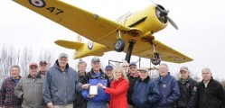 Haldimand-Norfolk MPP Toby Barrett and Karen Richardson of the Ontario Trillium Fund  joined members of the No. 6 RCAF Dunnville Museum to commemorate a $9,000 Ontario  Trillium Fund donation for restoring the Harvard seen above at the Dunnville  Airport.