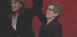 Pupatello (L) raises Wynne's (R) hand in the air during the Ontario Liberal Leadership Convention. Wynne is Ontario's new Leader. image:Mith Media/Silo