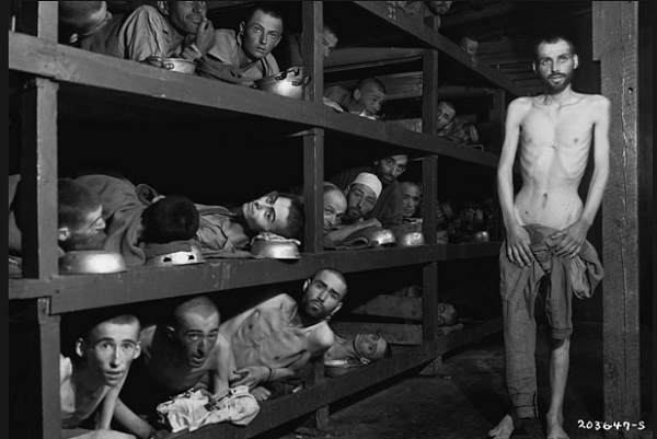 Survivors of Buchenwald Concentration Camp: Survivors at Buchenwald Concentration Camp remain in their barracks after liberation by Allies on April 16, 1945. Elie Wiesel, the Nobel Prize winning author of Night, is on the second bunk from the bottom, seventh from the left. Photo Credit: Corbis from history.com