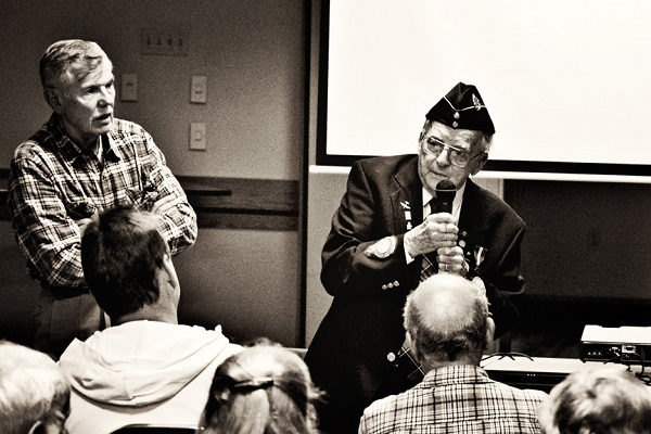 Canadian airman Ed Carter-Edwards speaks about surviving Buchenwald. image: Charity Blaine / The Silo