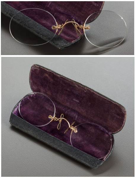 Renoir's pince-nez, spectacles popular in the 19th century supported without earpieces by pinching the bridge of the nose, in a hinged leather case with royal purple velvet lining. Estimate: $1,000 - $1,500.  Artist Unknown:.  Condition Report*: 4.25 x 1.5 inches