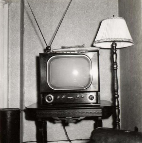 If you're approaching or passing 40 years of age, you might remember your grandparents having a set up like this. You might have dreaded the day you visited because you were forced to watch black and white television and fiddle around with the 'rabbit ears'. To those readers who have no idea what I'm talking about (LOL) the 'rabbit ears' are those two metal rods sticking up from the corner of the television set. The rods could be rotated, pulled apart, shortened and lengthened etc. All in the hopes of receiving a television signal as clearly as possible. There was an art to this stuff. Trust me, I'm old. CP